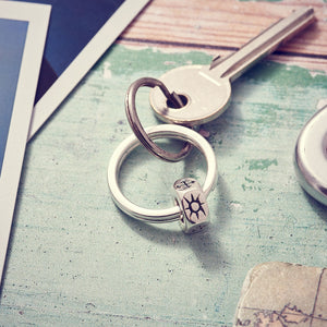 Alternative gap year gift for travellers - chunky silver keyring engraved with initials - alternative to St. Christopher from Off The Map Jewellery Brighton