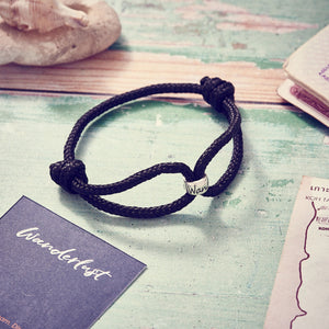 Wanderlust Vegan Paracord Bracelet in black with silver engraved wanderlust charm