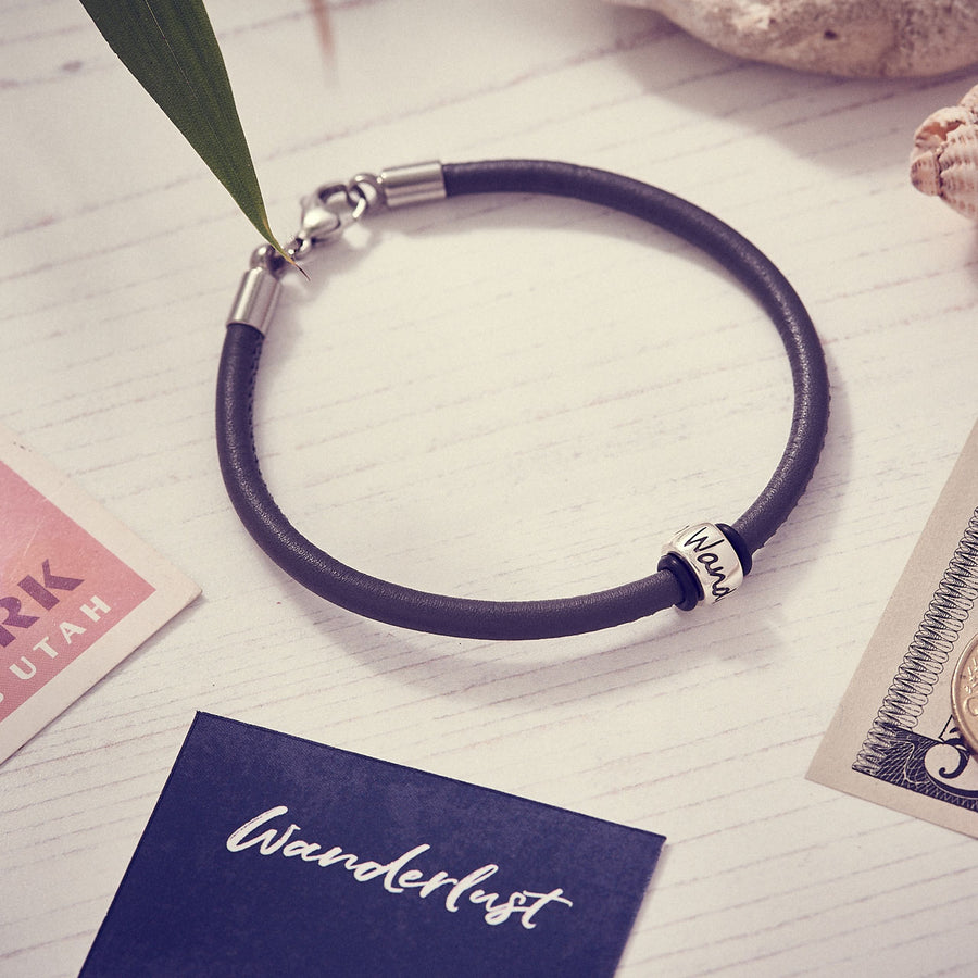 Black mens leather bracelet with silver wanderlust charm bead