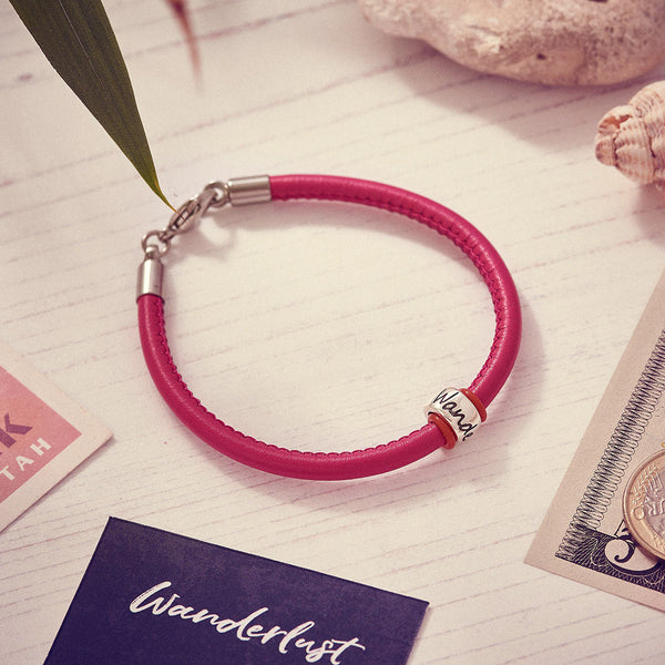 ladies pink leather bracelet with wanderlust bead unusual travel gift for her
