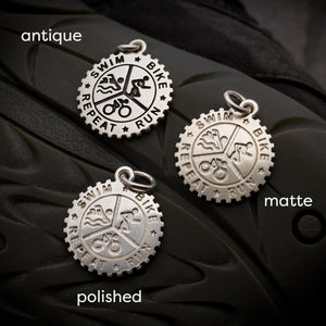 Men's silver triathlon pendant with leather or silver cord from Off The Map Jewellery