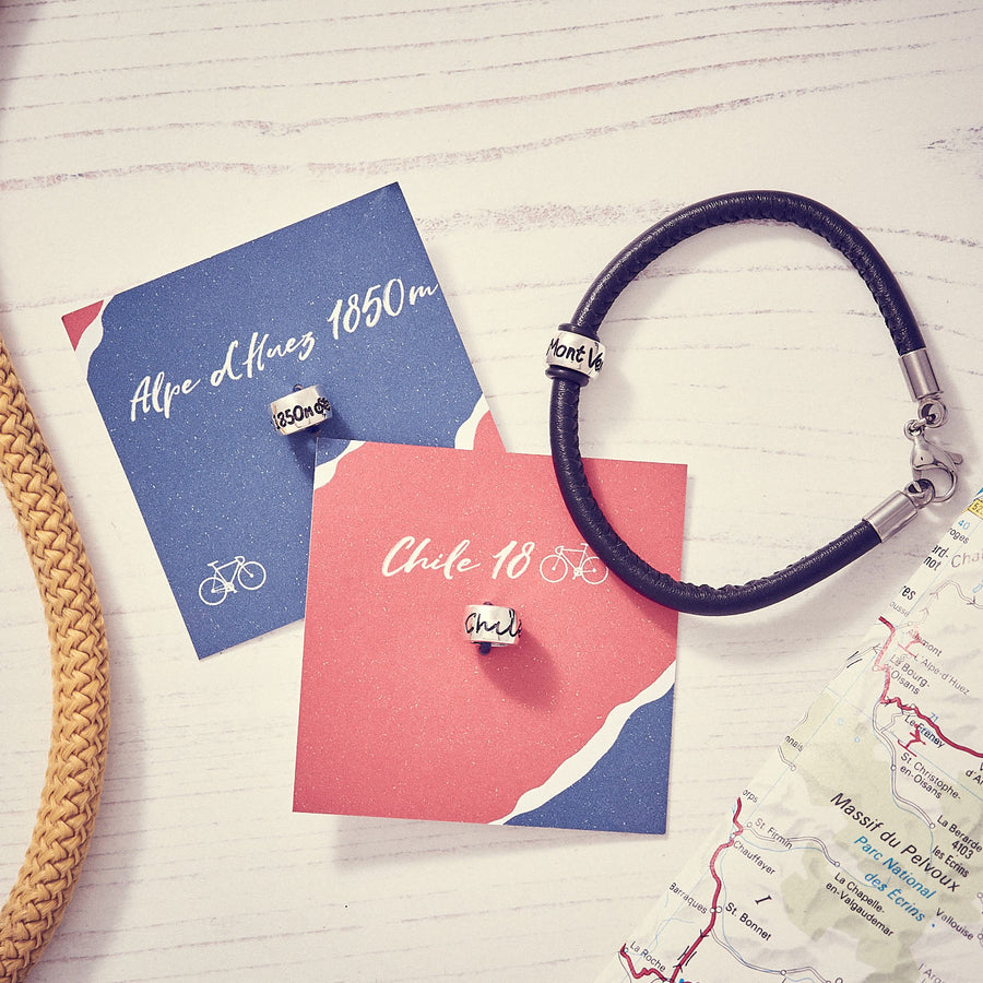 Personalised Silver Travel Country Bead Engraved with mountain altitude, cycle race, hiking. Gift from Off The Map Jewellery Brighton