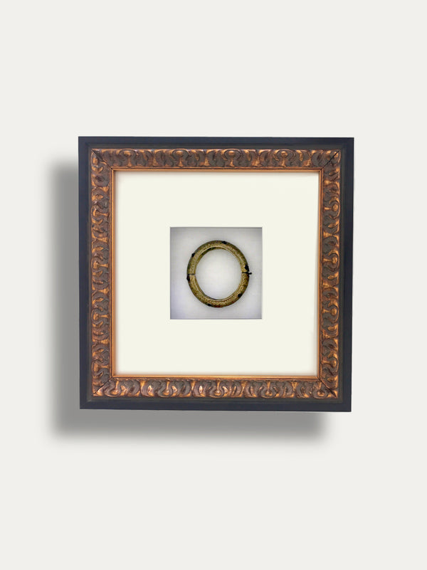 A GORGEOUS WEDDING BANGLE IN BRASS AND GLASS FROM BALI INCAPSULATED INSIDE A WOODEN FRAME. A SYMBOL OF ETERNAL LOVE