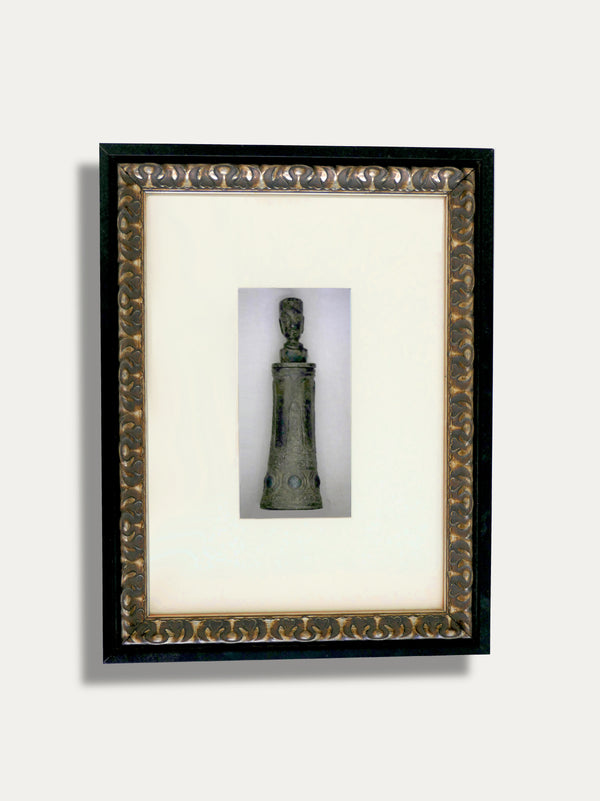 A FRAME WITH TEMPAT KAPUR, A MEDICINE BOTTLE IN BRASS FROM TANIMBAR. LIMITED EDITION FROM THE 1970'S! A SYMBOL OF HEALTH