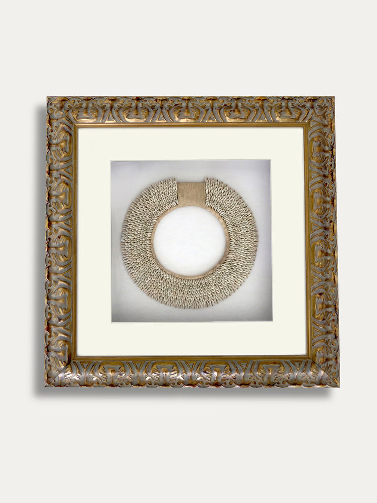 FRAME WITH A COWRIE SHELL NECKLACE INCAPSULATED INSIDE A BEAUTIFUL WOODEN FRAME, A SYMBOL OF ETERNAL LIFE