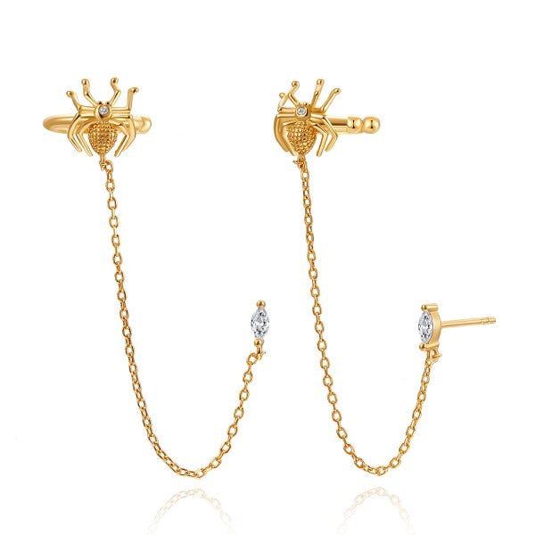 ear cuff de araña con cadena y pendiente de brillante confeccionados en plata de ley con baño de oro 18 kilates.  Gold plated silver Spider ear cuff earring with chain for piercing