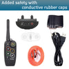 PetSpy M686 package: receiver, transmitter, orange collar, charger with USB cable, test light, manual.
