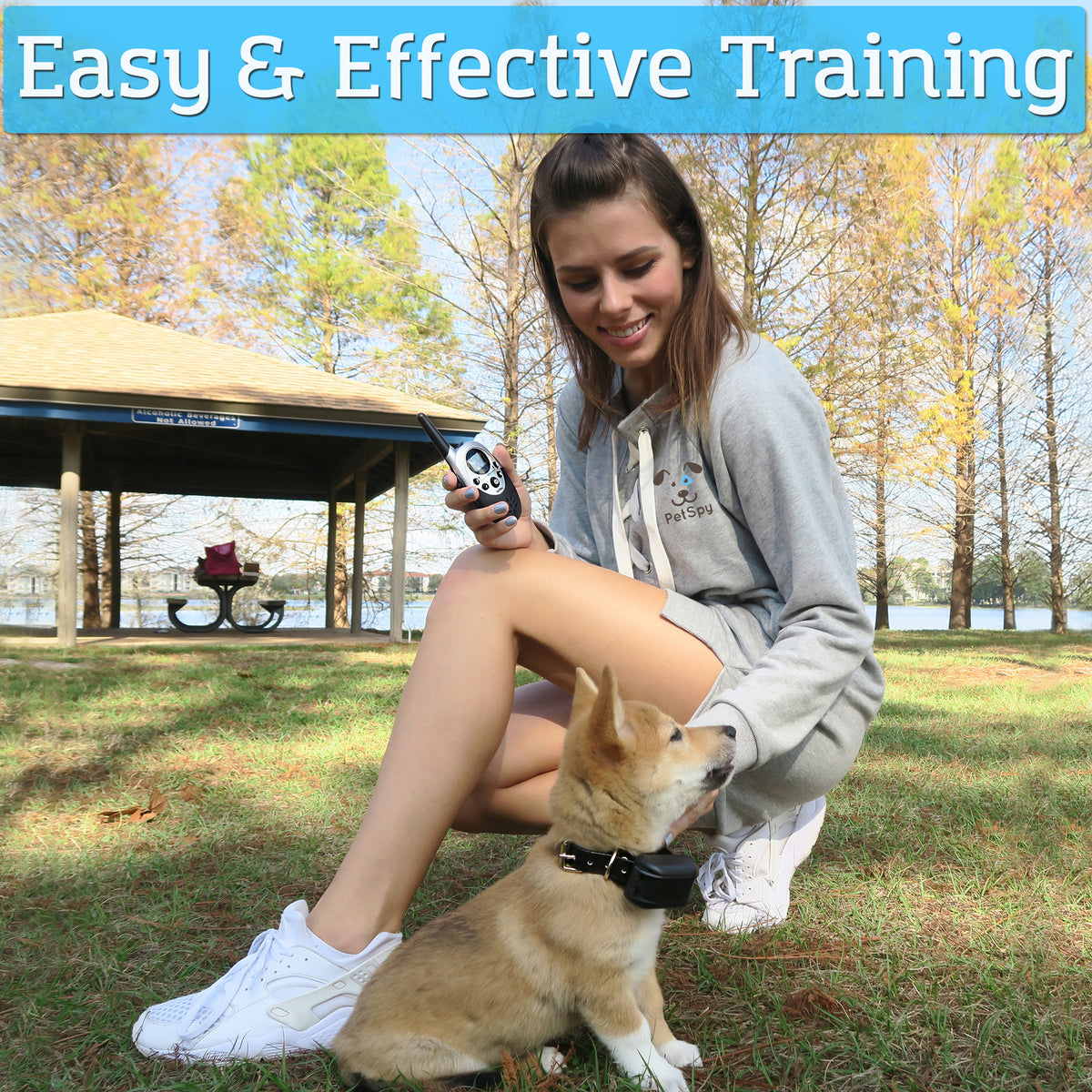 Girl training her puppy with PetSpy dog shock collar
