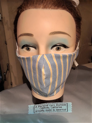 A Personal Care Boutique Face Mask cotton handsewn in California preppy blue with stripes of yellow and white