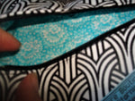 A Personal Care Boutique heart zipper pouch black and white, turquoise lined