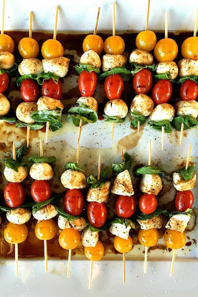 10 Best Appetizers to bring to a Holiday Party Mini Caprese Skewers by Reluctant Entertainer
