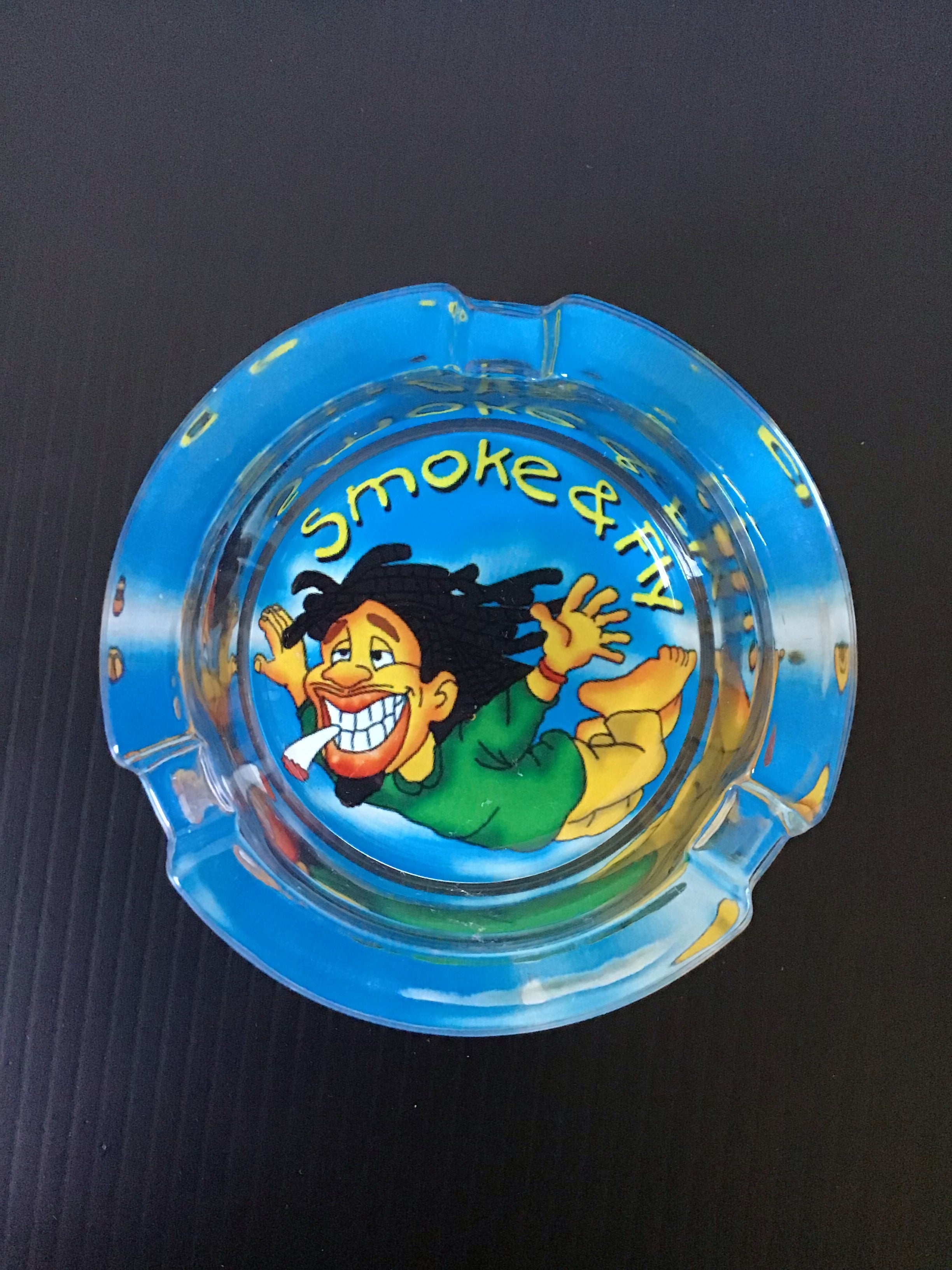 Smoke and Fly Blue Rasta and Jamaican Design Glass Ashtray yoga, yoga smokes, tattoo, face, nails, nail, glass retail, online, web, weborder, website, tanks, lounge, odor, smoke shop near me, liquid smoke, smoke shop, lounge, smoke lounge, stoner, smoke, high, life, highlife, dabber, love, stoned, highsociety.