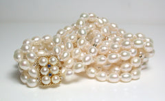 4 strand pearl and gold bead necklace