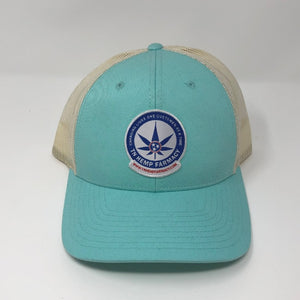 Aqua trucker style hat with the TN Hemp Farmacy logo on front.