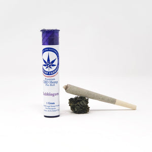 One gram (1g) potent CBD prerolled smokable hemp cone with a plastic childproof pop top container.