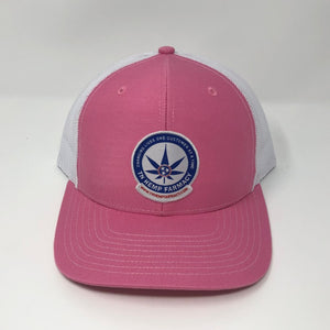 Pink trucker style hat with the TN Hemp Farmacy logo on front.