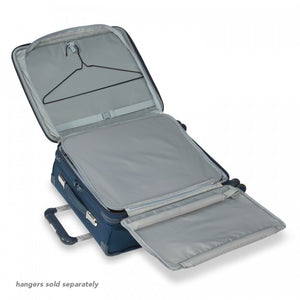 Briggs & Riley Baseline International Carry-On Expandable Wide-Body Spinner in Navy garment suiter