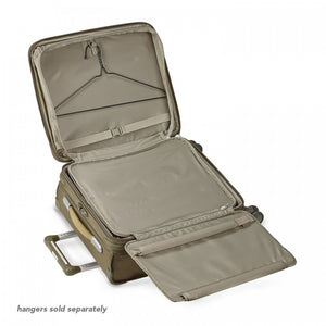 Briggs & Riley Baseline International Carry-On Expandable Wide-Body Spinner in Olive garment suiter