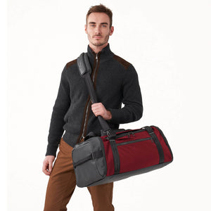 Briggs & Riley ZDX Large Travel Duffle in Brick on model
