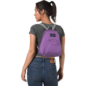 JanSport Half Pint Backpack in Vivid Lilac on model