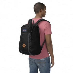 JanSport Foxhole Backpack in Black on model