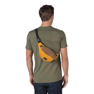 JanSport Fifth Ave Suede Fanny Pack in English Mustard on model