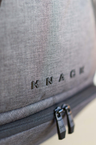 Professional, suit-inspired fabric on an everyday carry backpack