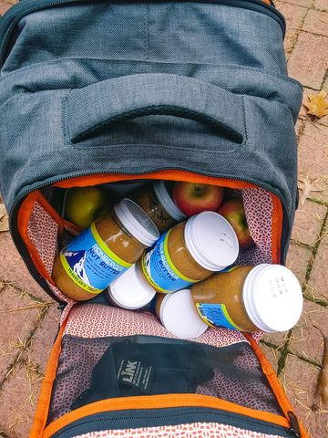 jars of Reinberger nut butter in an expandable Knack Pack laptop backpack