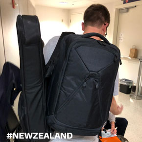 Brian carrying a guitar and his large Knack Pack on a recent family vacation to New Zealand