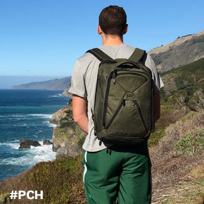 College student using green Knack Pack on a trip down the Pacific Coast Highway