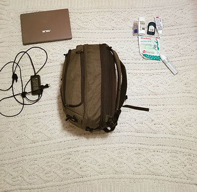 Robert packs his laptop, cords and toiletries in his Knack Pack travel backpack