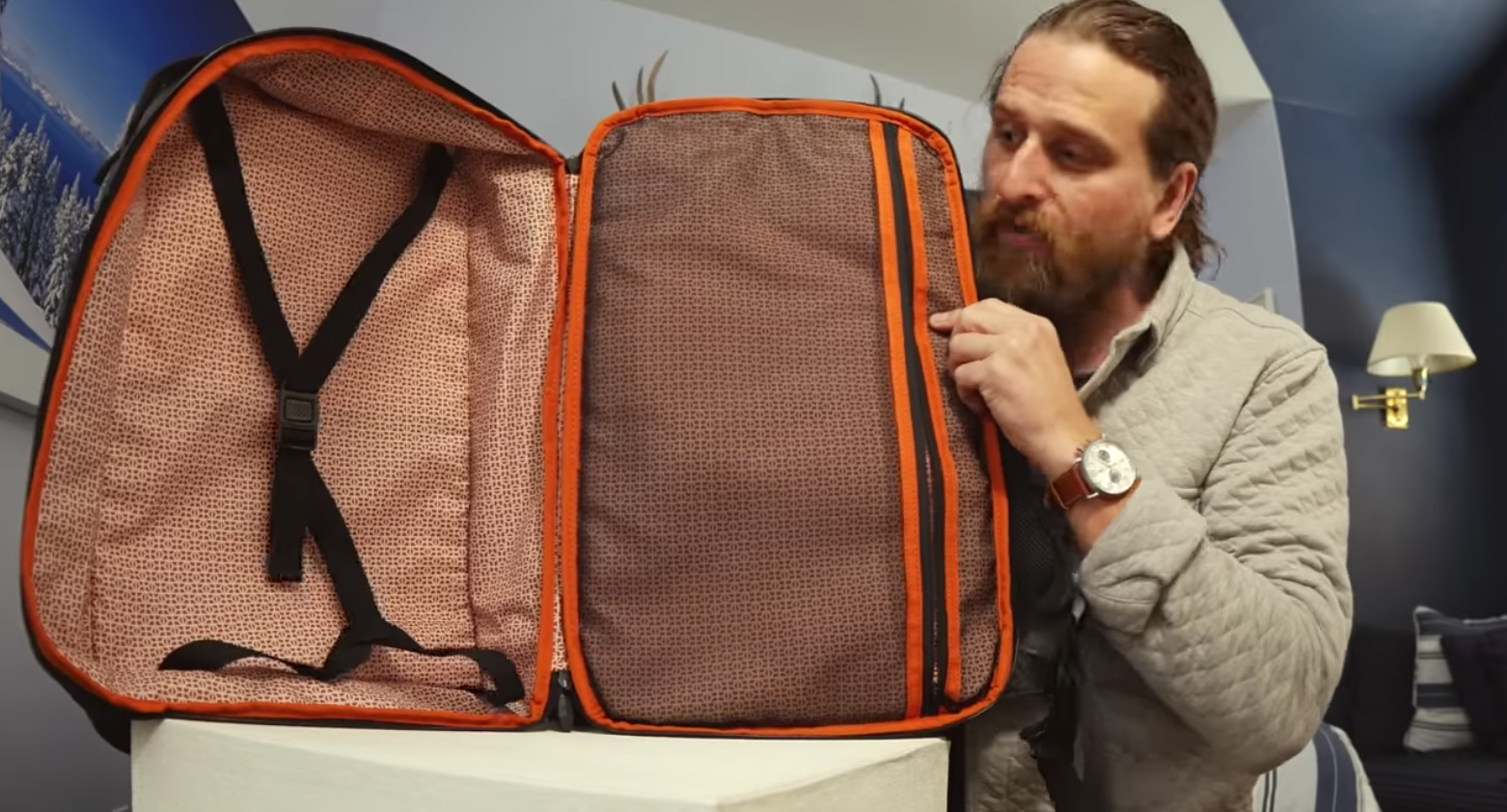 Chase Reeves reviewing the expandable luggage compartment on the Knack Pack backpack