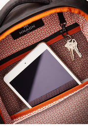 Spacious main compartment with organization pockets, fleece-lined tablet pocket and key leash