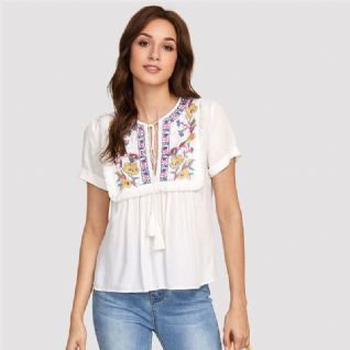 EMBROIDERED TOP FRINGING AND TASSELS