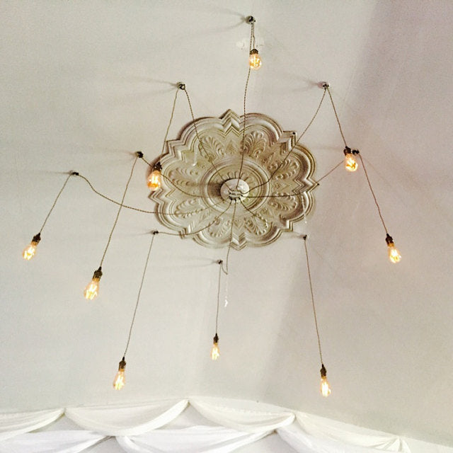 swag chandelier with ornamental ceiling plate