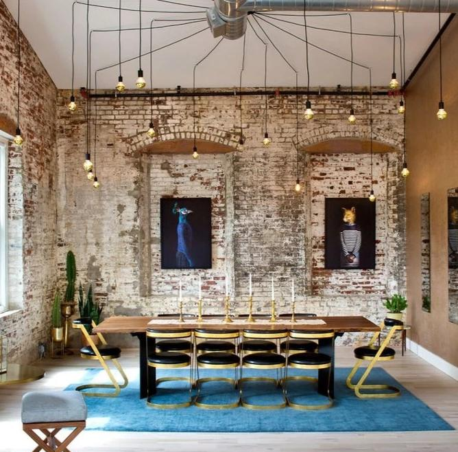 unique swag chandelier over dining table with brick