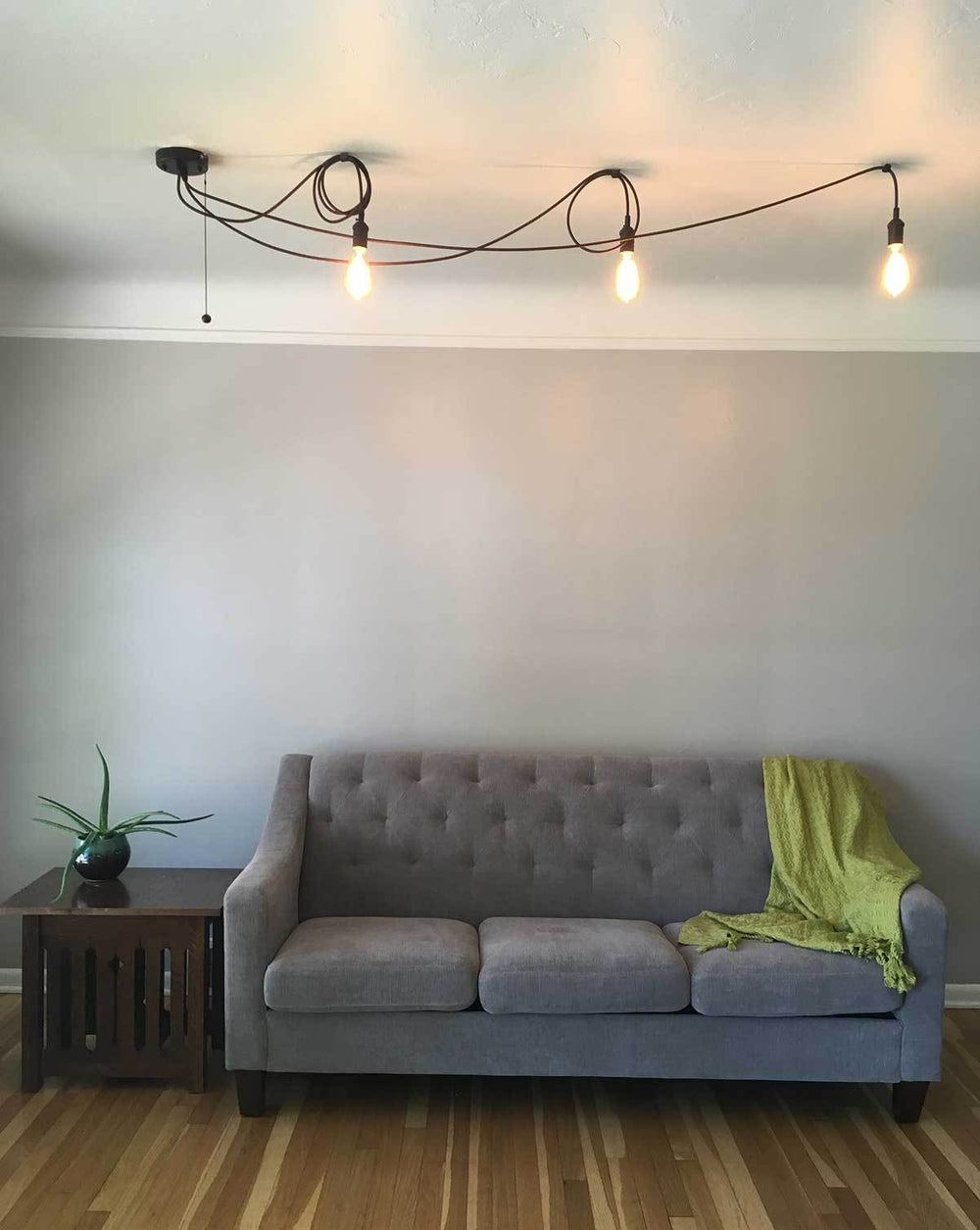 cute 3 pendant swag chandelier over couch