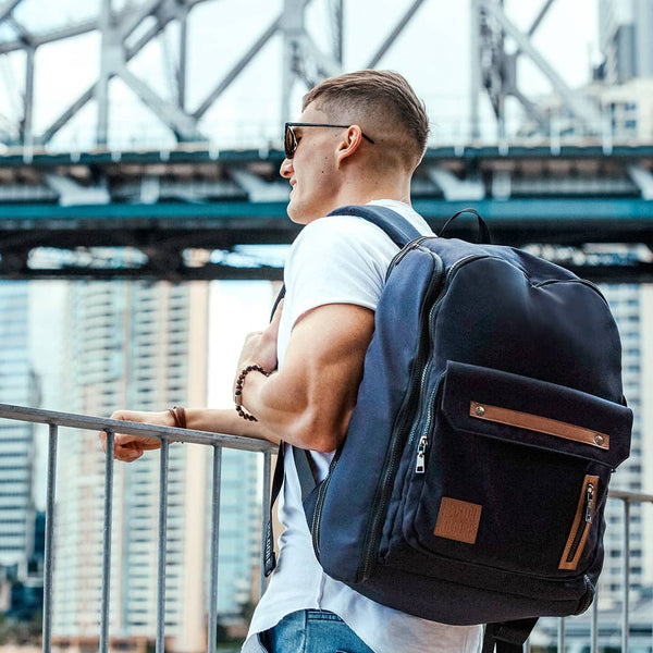 Man in the city with black backpack for work