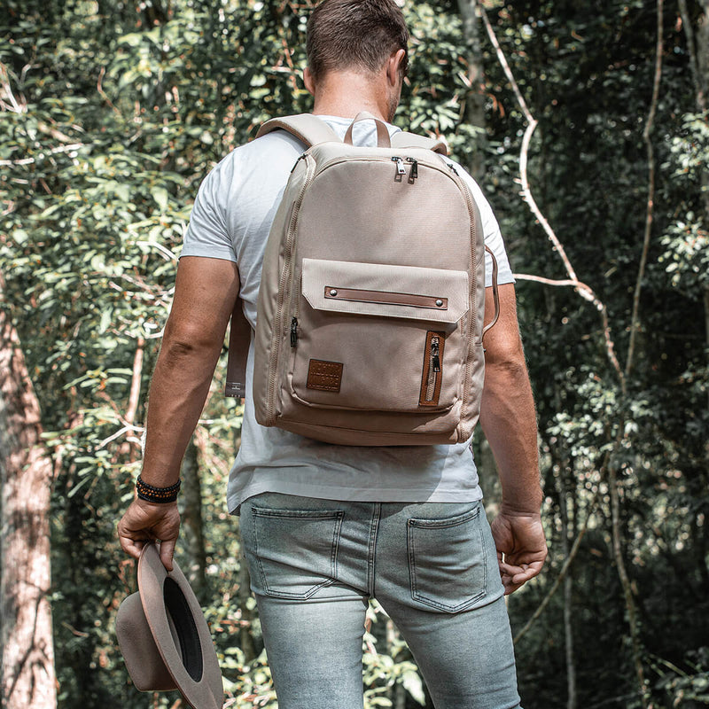 Man wearing Beige Cream backpack travel bag carry on gym bag recycled