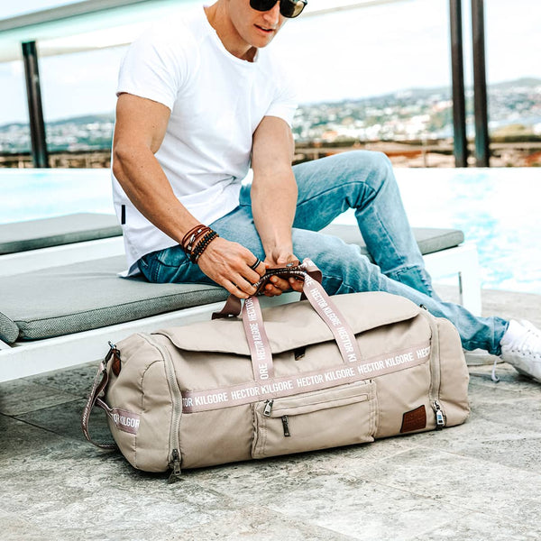 Man with Beige Cream Duffle travel bag gym bag carry on recycled