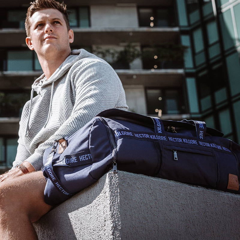 Man with Navy Blue Duffle travel bag