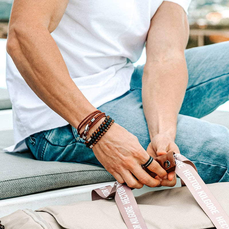 Man wearing stacked natural brown genuine leather wrap and beaded bracelet stack