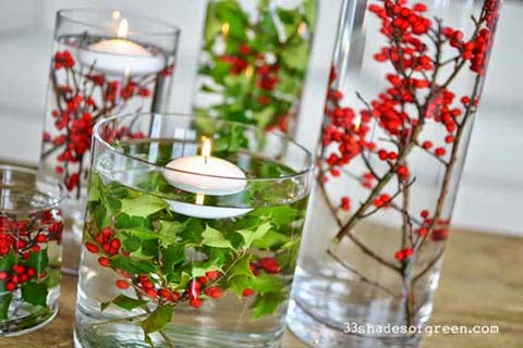 Christmas table decorations with natural foliage and berries