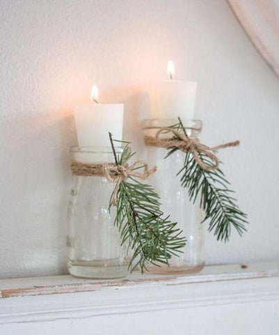 Candles with natural foliage decoration