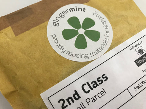 Ginger Mint's logo sticker on a re-used padded envelope stating it has been re-used and recycled
