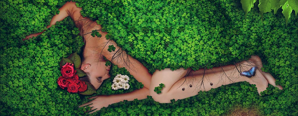 Naked woman lying on a woodland carpet of plants