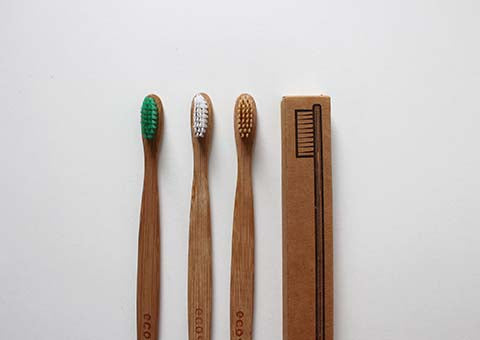 A line of bamboo toothbrushes