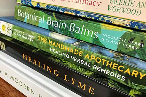 A stack of herbal books