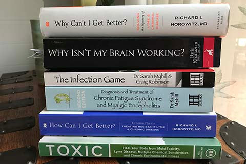 A stack of medical textbooks