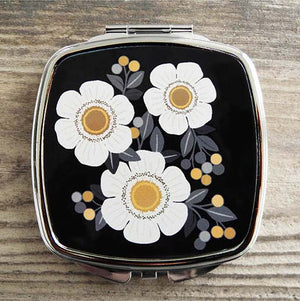 Amber white flowers on black background compact mirror